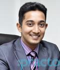 Dr. Arjun Panikar - Dentist