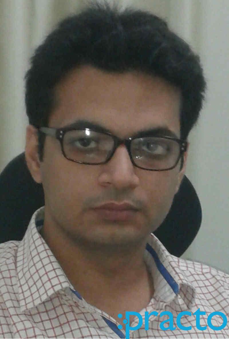 Dr. Puru Dhawan
