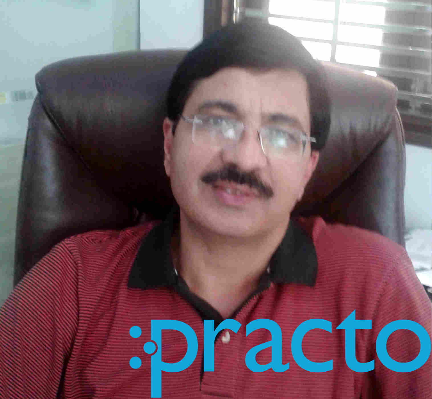 Dr. Praveen Bhatia  - Dentist