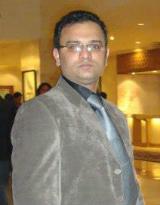 Dr. Naveen Chauhan - Dentist