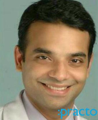 Dr. Nitin Sharma - Dentist