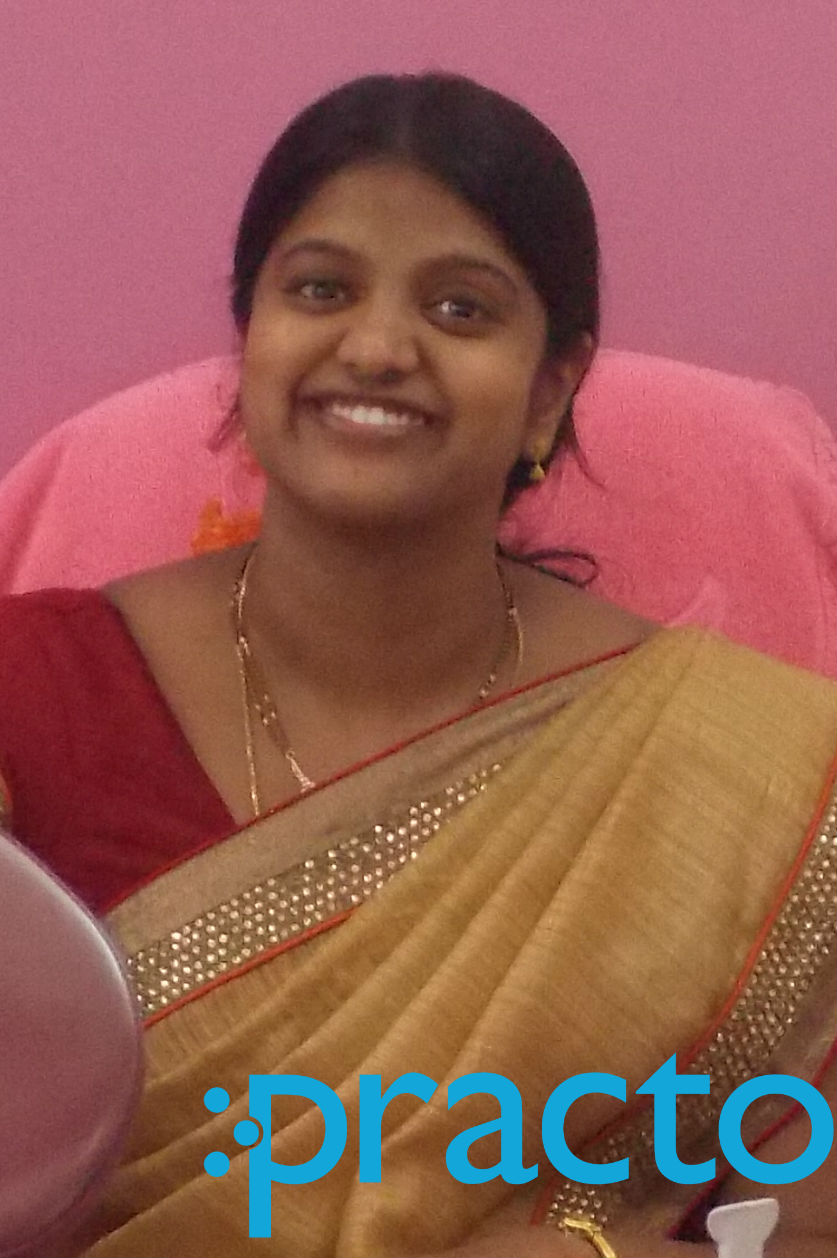 Dr. Asha Praveena - Dentist