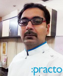 Dr. Kapil Kalra - Dentist