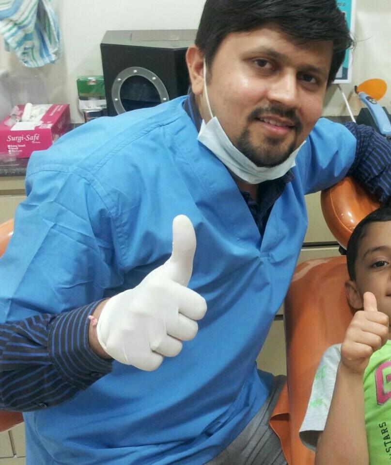 Dr. Milind L. Shah - Dentist