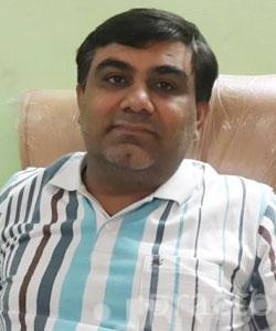 Dr. Dharmesh M. Thakkar - Dentist