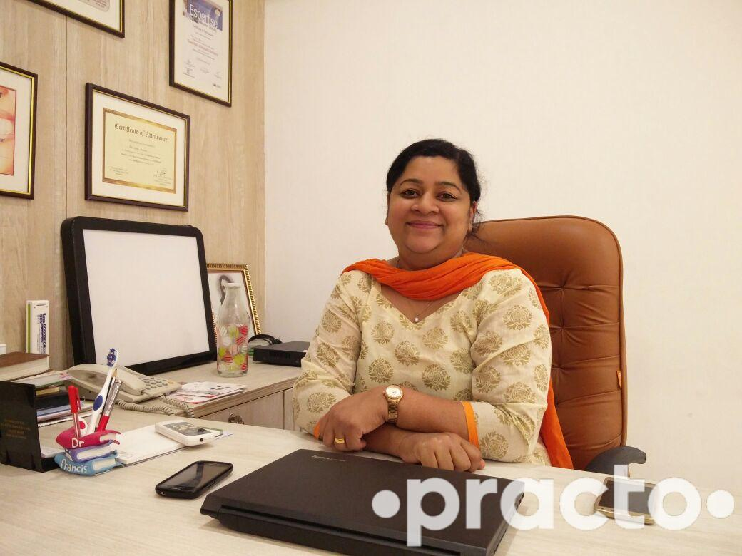 Dr. Suja Francis - Dentist