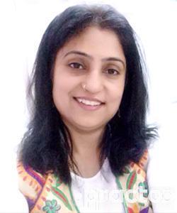 Dr. Meena Joshi - Dentist