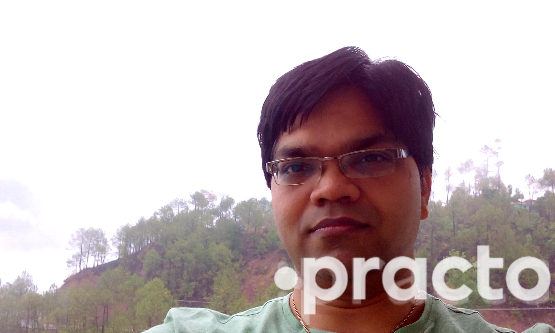 Dr. Manish Sharma - Dentist