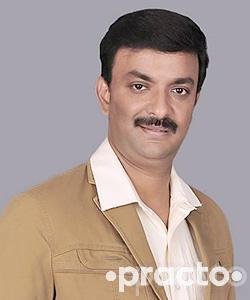 Dr. Suresh - Dentist