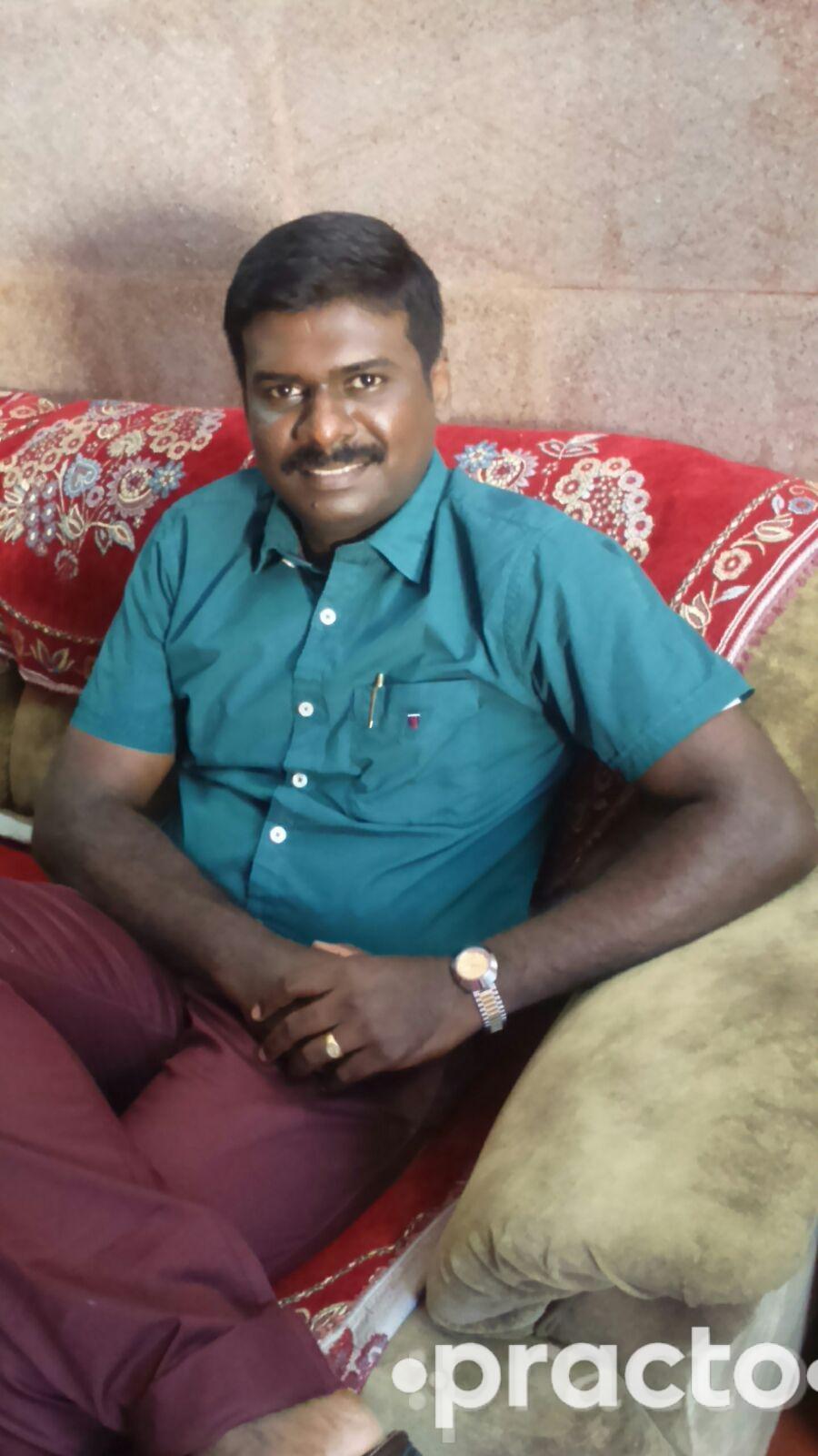 Dr. J. Anandaraj Paul - Dentist