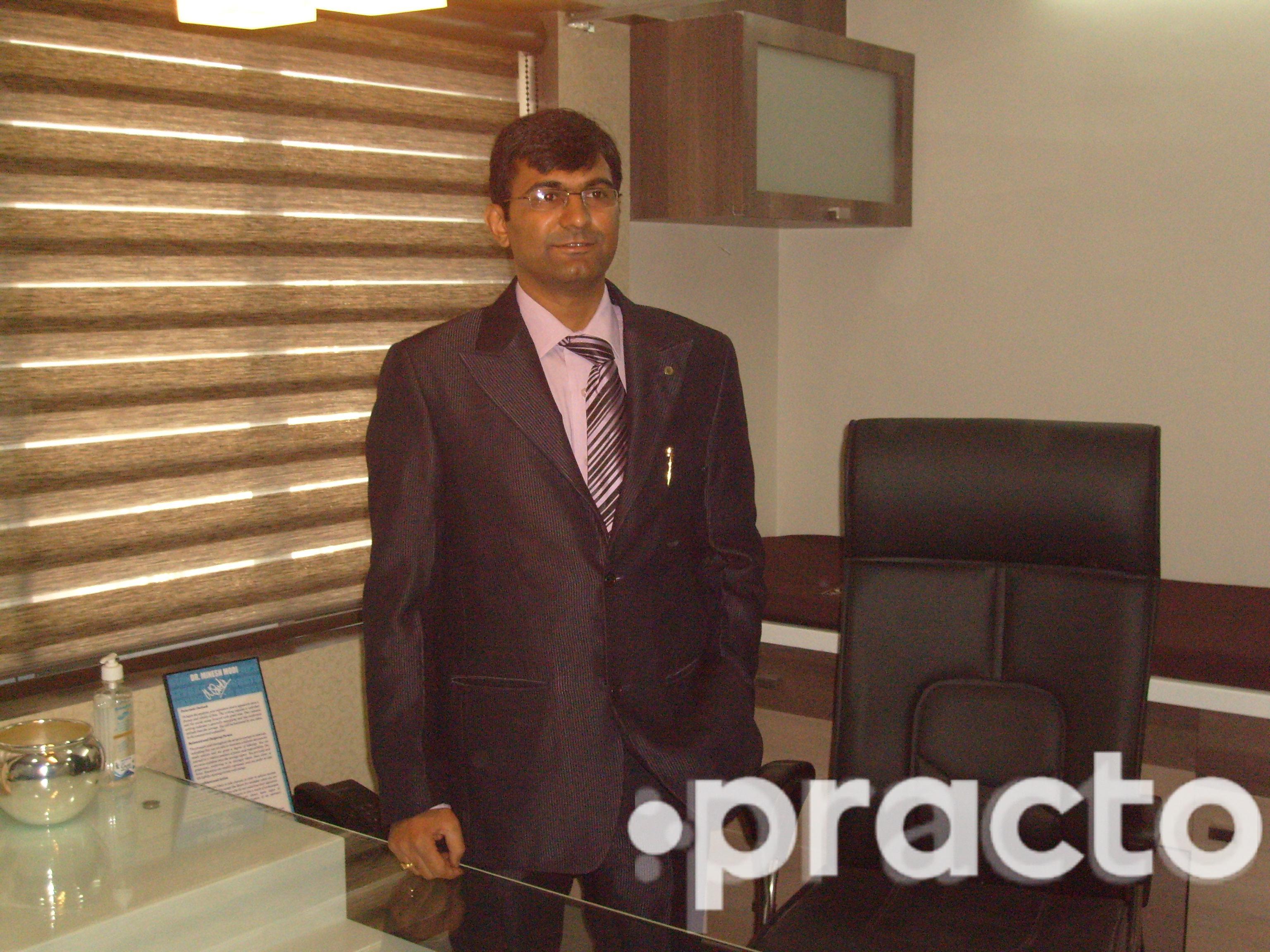 Dr. Minesh Modi