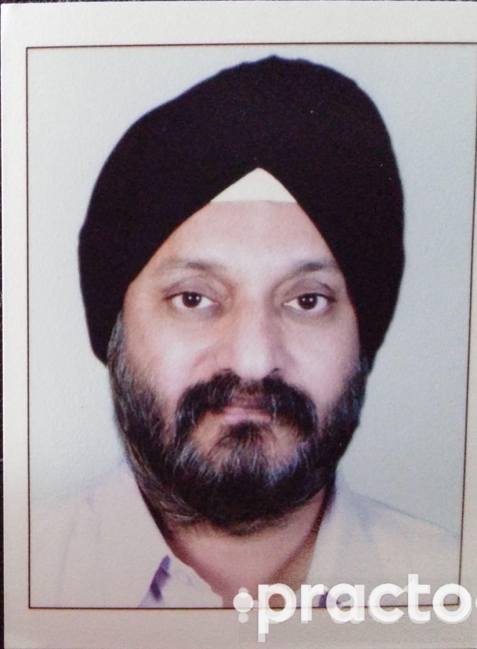 Dr. Amarjeet Singh Gujral - Dentist
