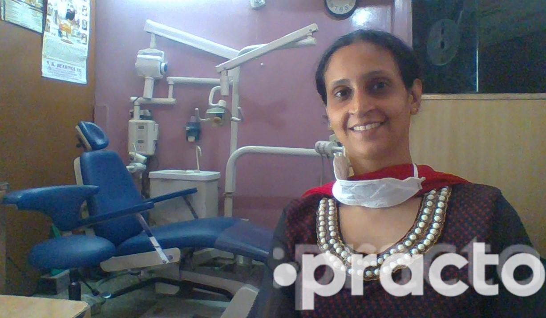 Dr. Amarjeet Saini - Dentist