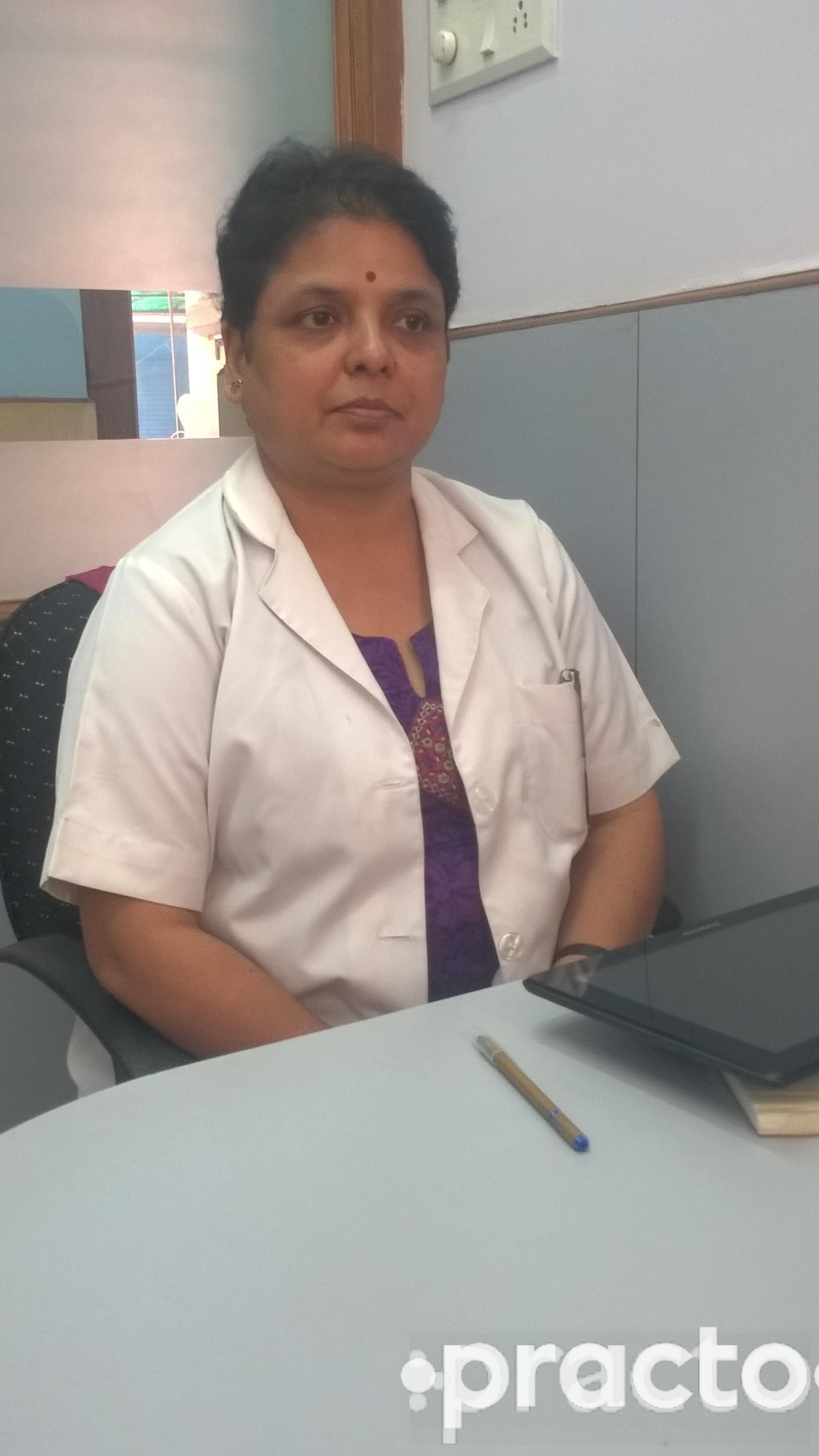 Dr. Monisha Shah - Dentist
