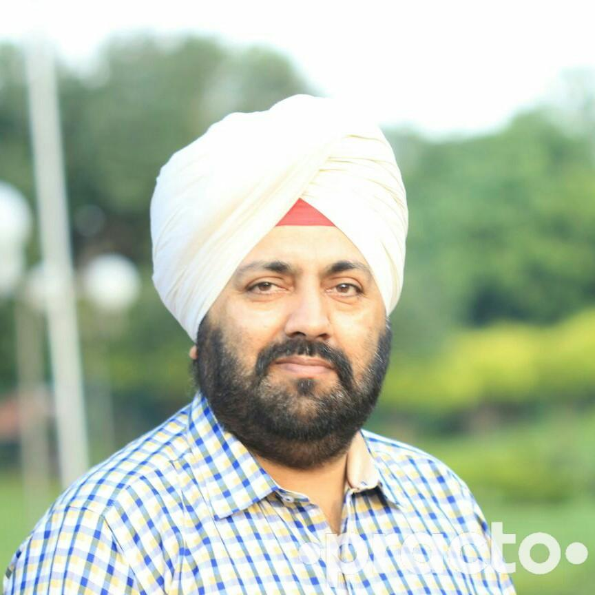 Dr. Rajan Bir Singh Thind - Dentist
