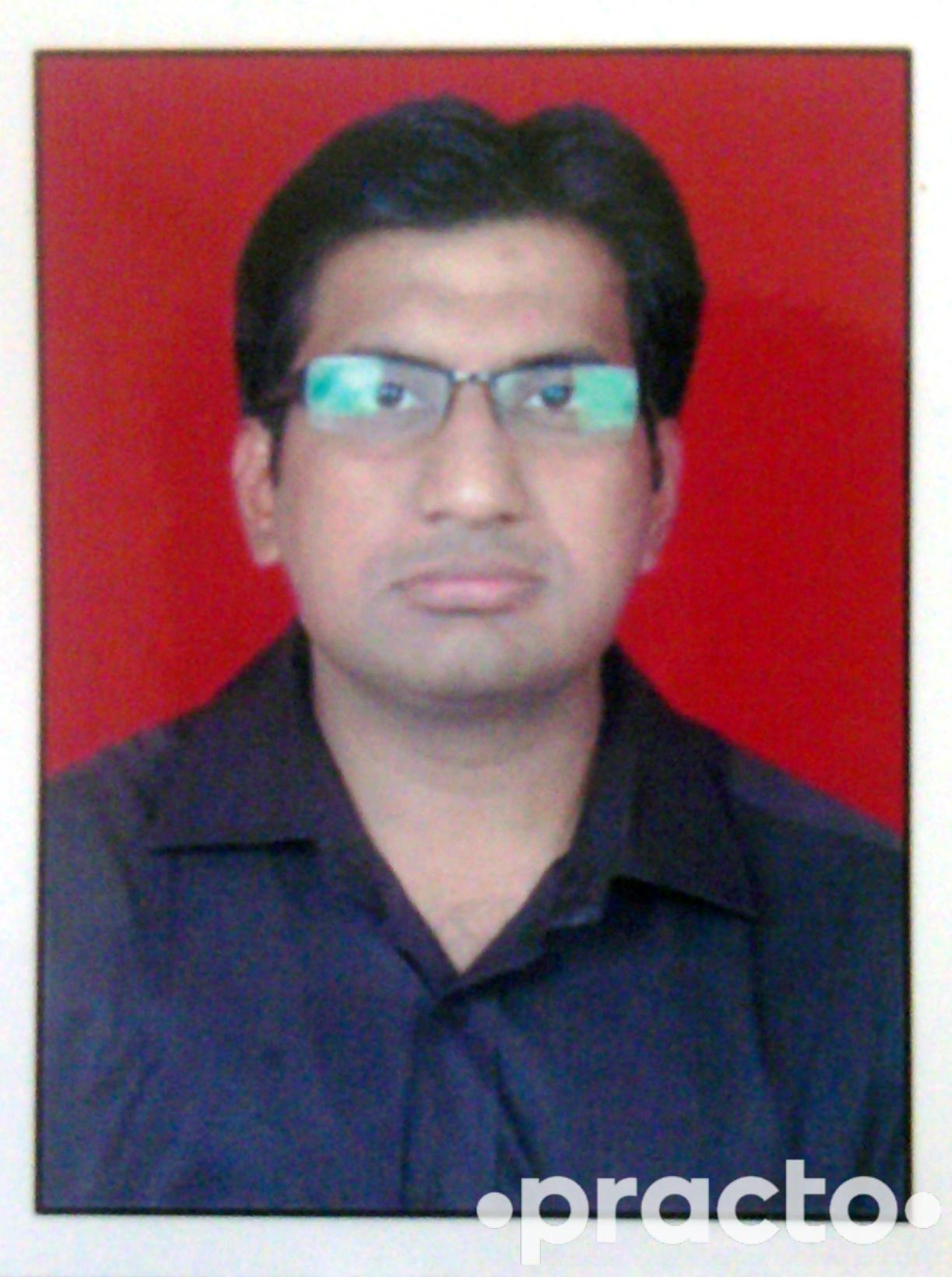 Dr. Abhilesh Darade