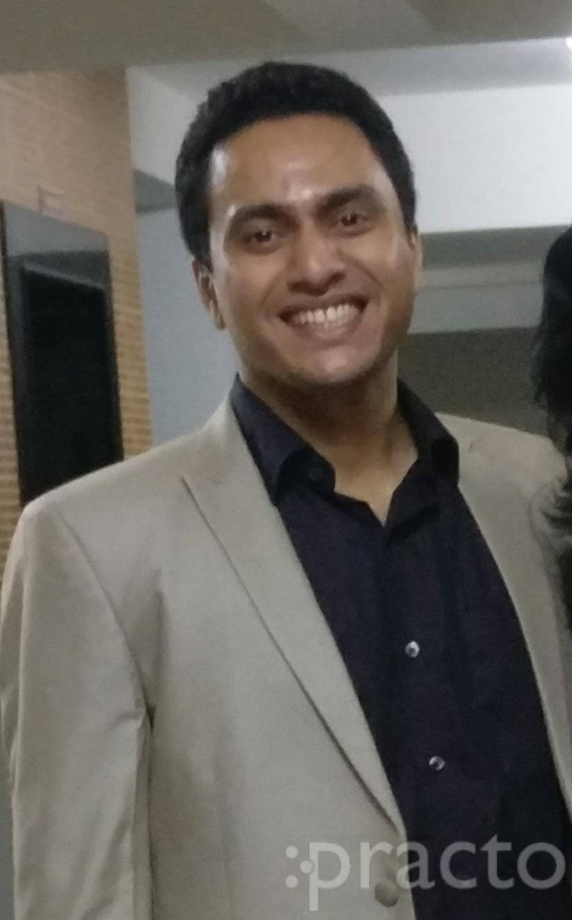 Dr. Abhijit V. Shetty - Dentist