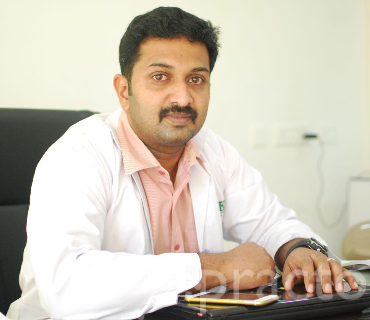 Dr. Abraham Philip - Dentist