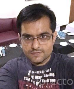 Dr. Achint Chachada - Dentist