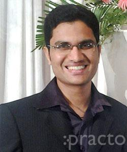 Dr. Adarsh Shetty - Dentist