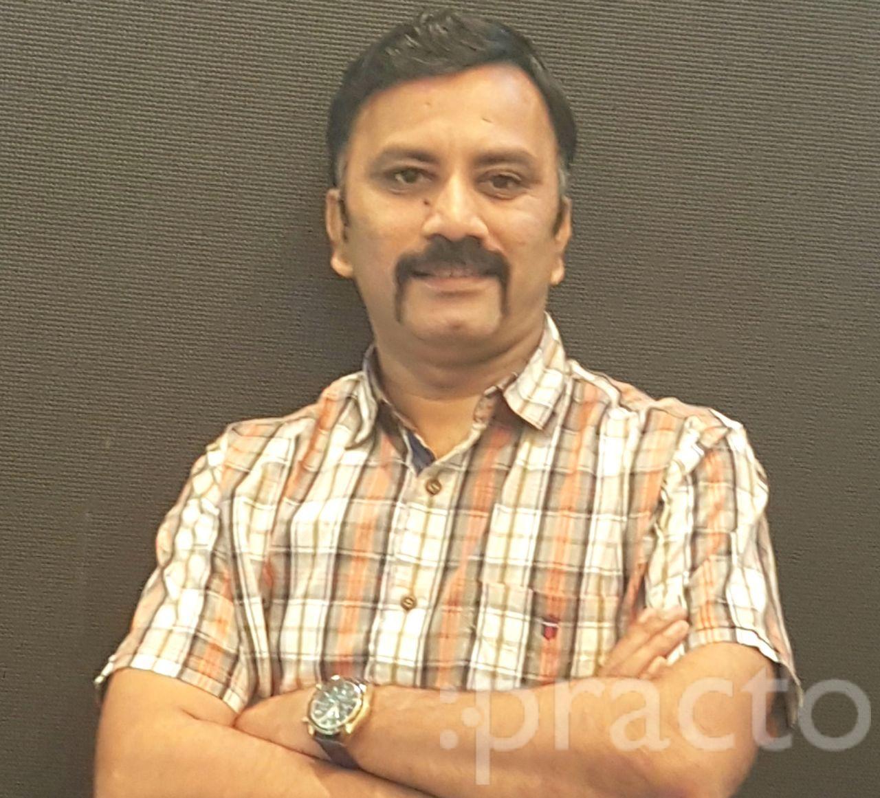 Dr. Ajay Mootha - Dentist