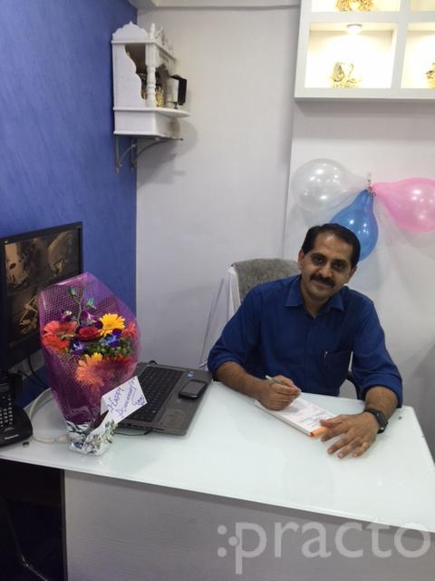 Dr. Ajay Thaker - Dentist