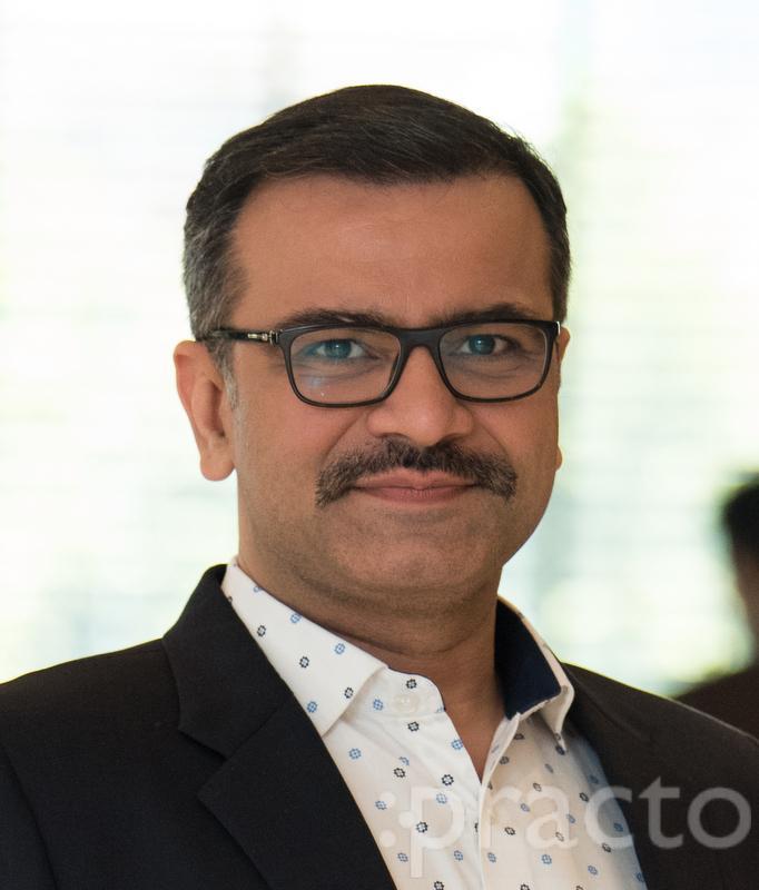 Dr. Amit Jhuraney - Dentist