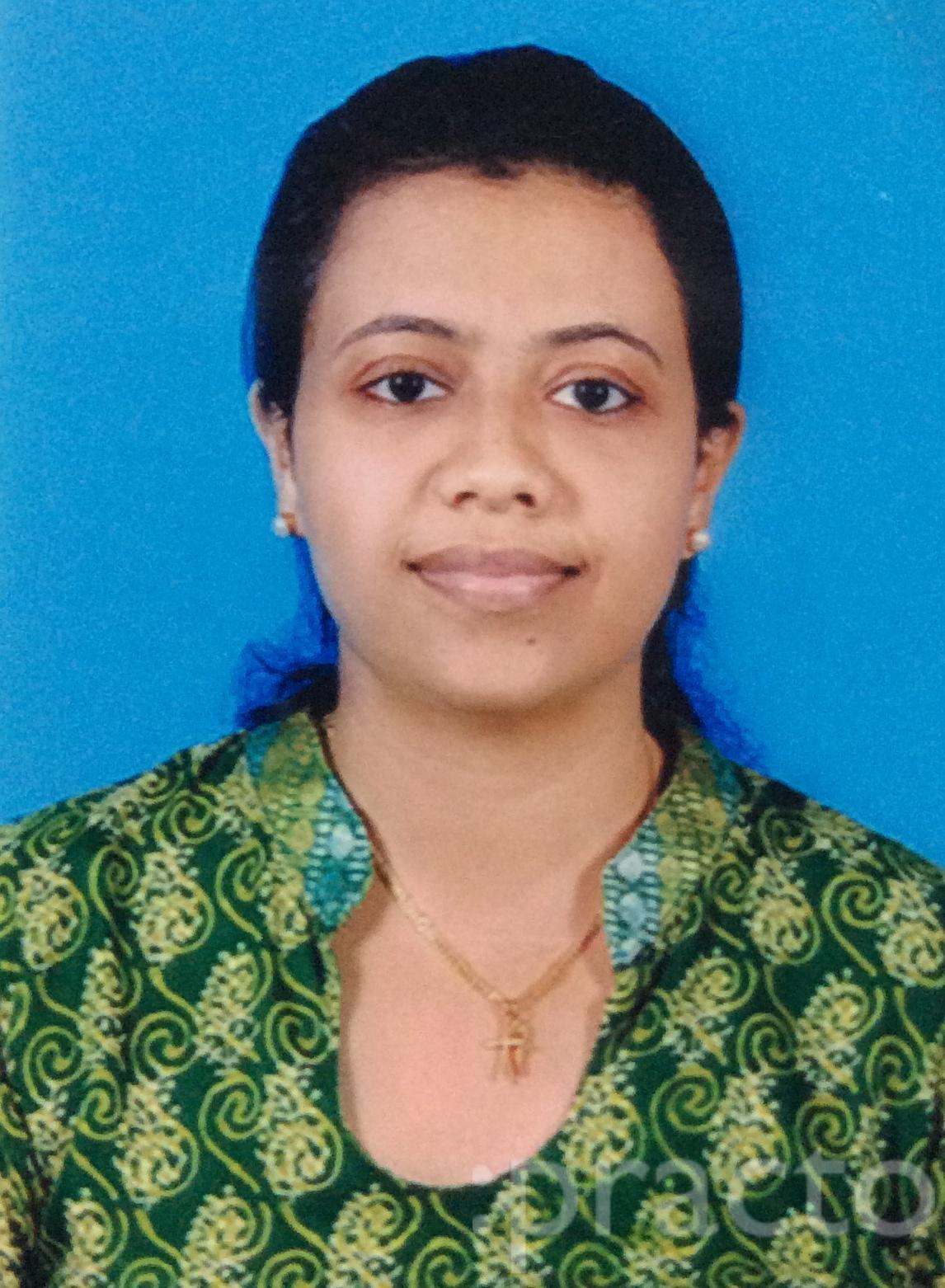 Dr. Anjum Anna Varughese - Dentist