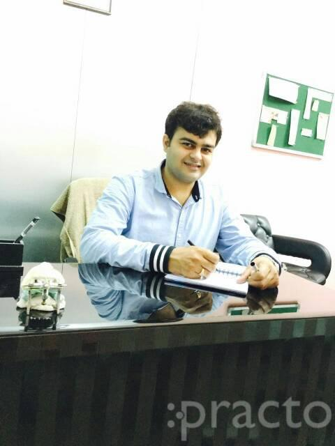 Dr. Ankit Sharma - Dentist