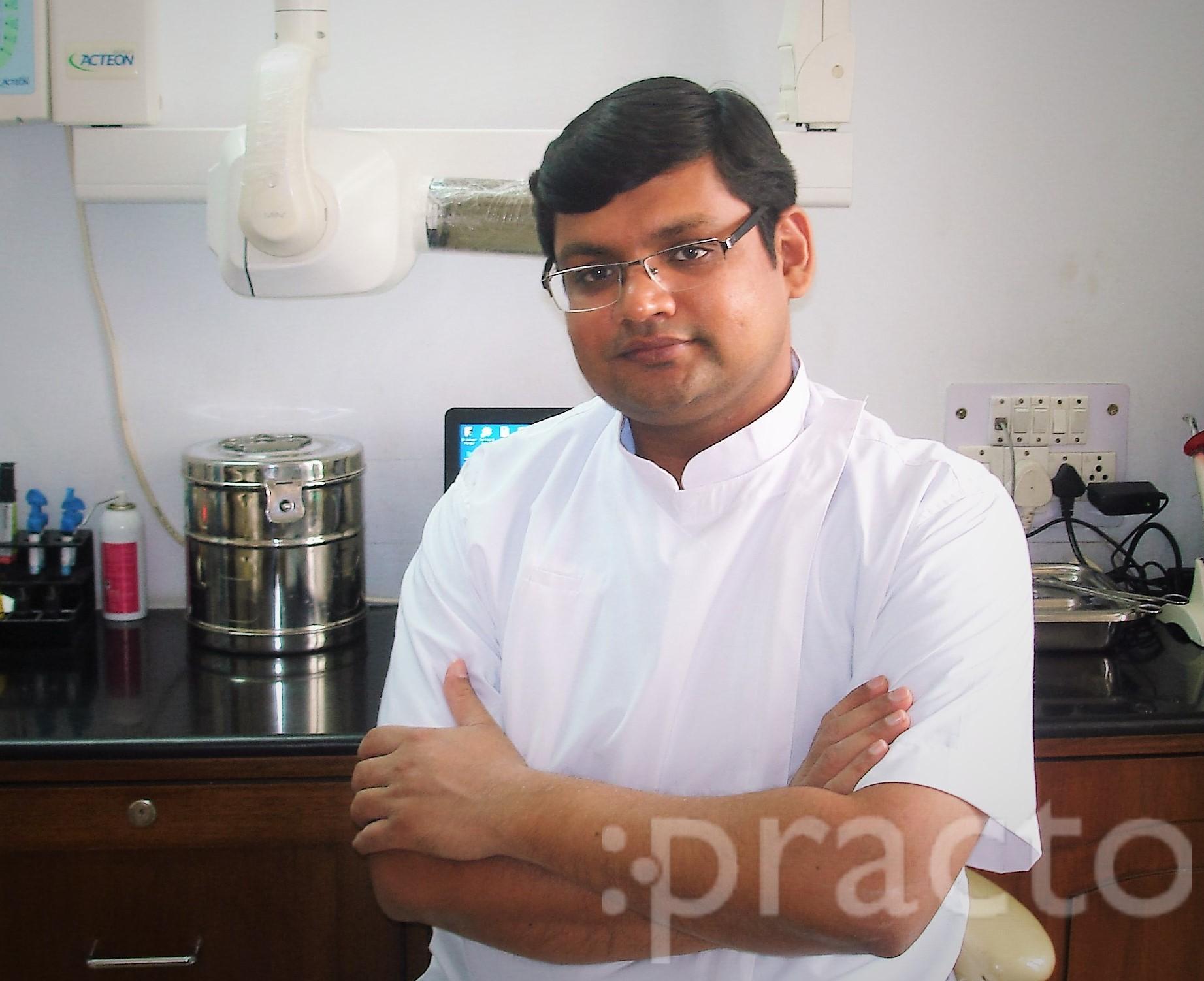 Dr. Asheesh Mangla - Dentist
