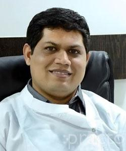 Dr. Bhushan Patil - Dentist