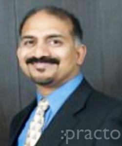 Dr. Binu Mathews - Dentist