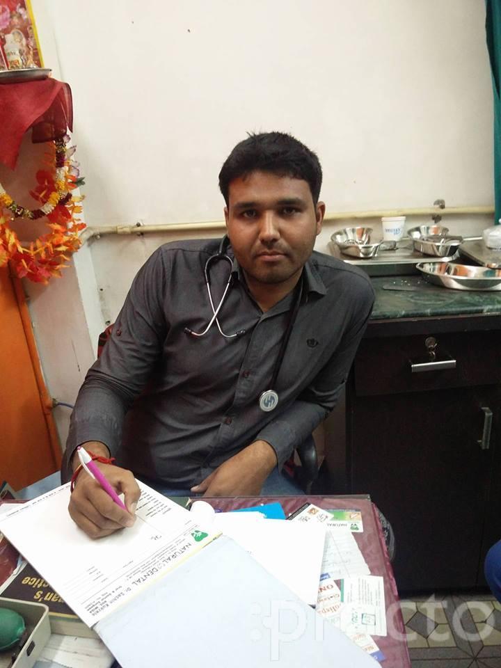 Dr. Dheeraj Sharma - Dentist