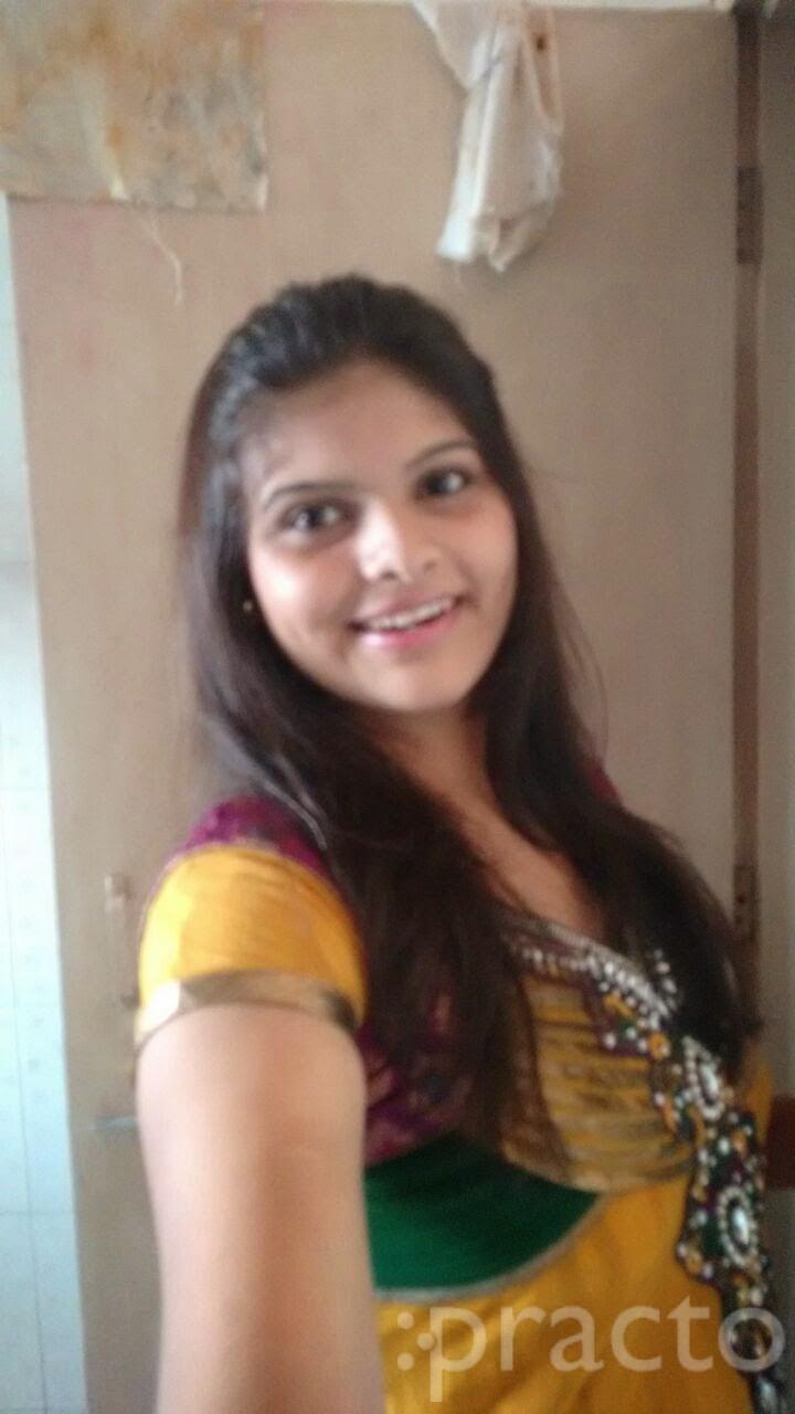 Dr. Esha Shah - Dentist