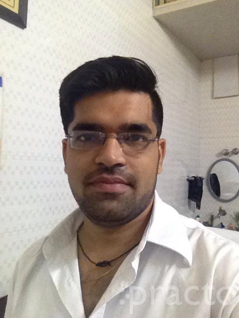 Dr. Hirak Shah - Dentist