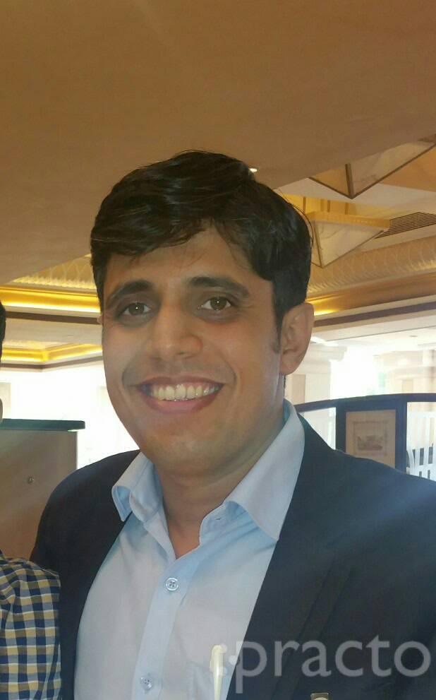 Dr. Kartik Raman - Dentist