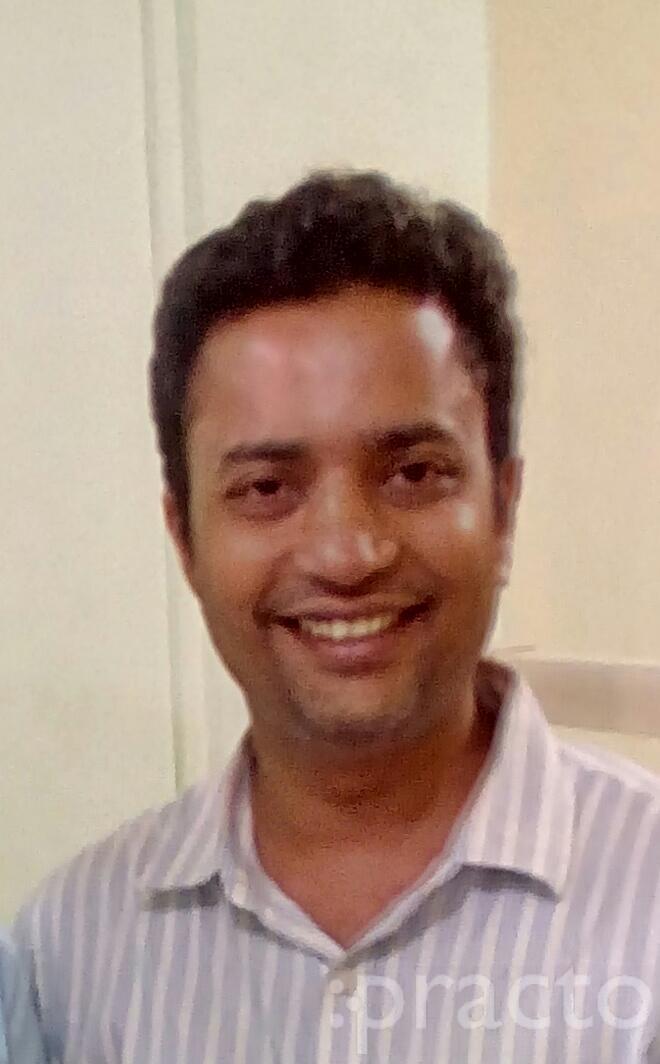 Dr. Kedar Karnik - Dentist