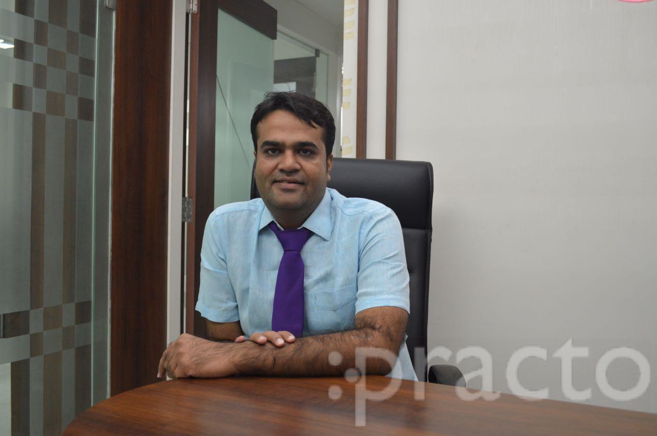 Dr. Kiran Patel - Dentist