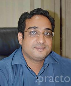 Dr. Koganti Ravichandra - Dentist