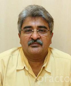 Dr. Kumar M. Tipnis - Dentist