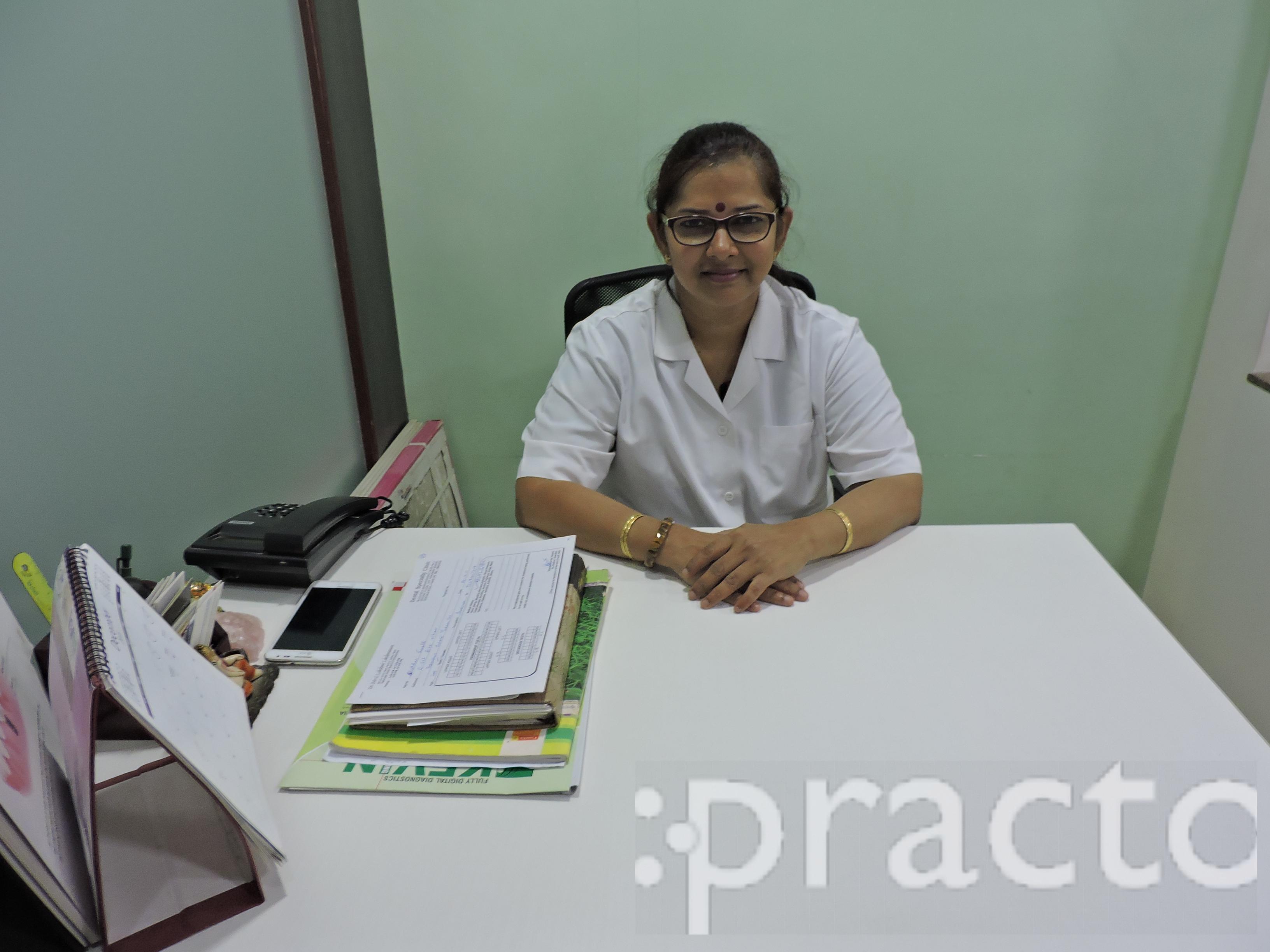 Dr. Lakshmi Lakshmanan - Dentist