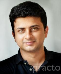 Dr. Madhur Navlani - Dentist
