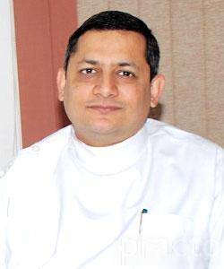 Dr. Manish Kalra - Dentist