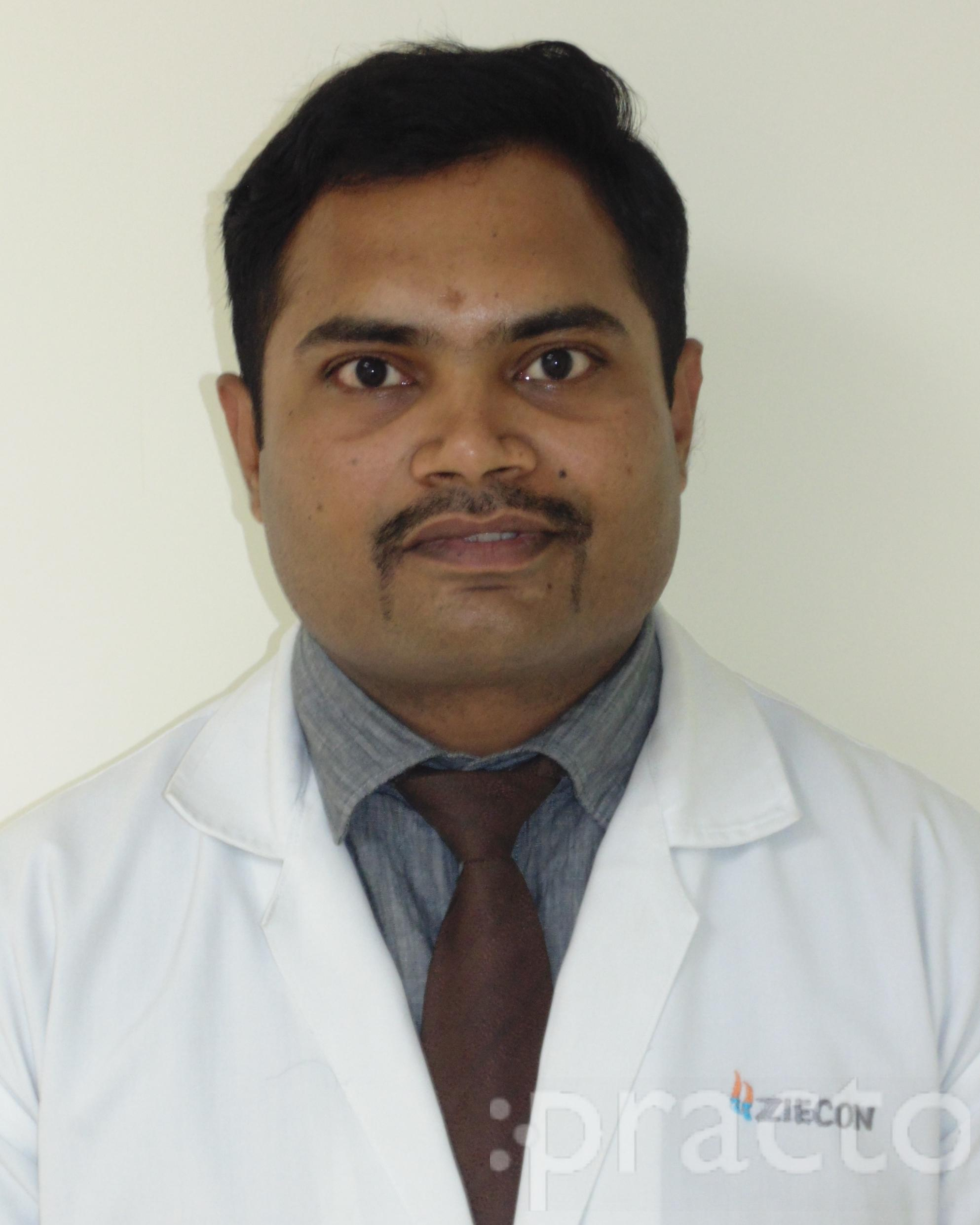 Dr. Mukesh Nikam - Dentist