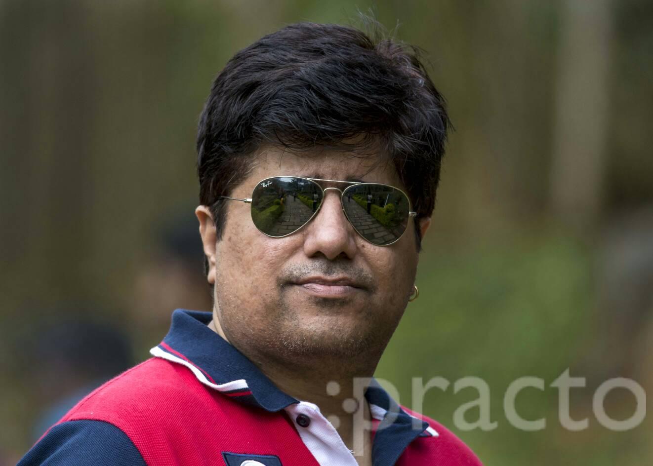 Dr. Neeraj Panchal - Dentist