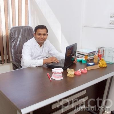 Dr. Nirmit Shah - Dentist