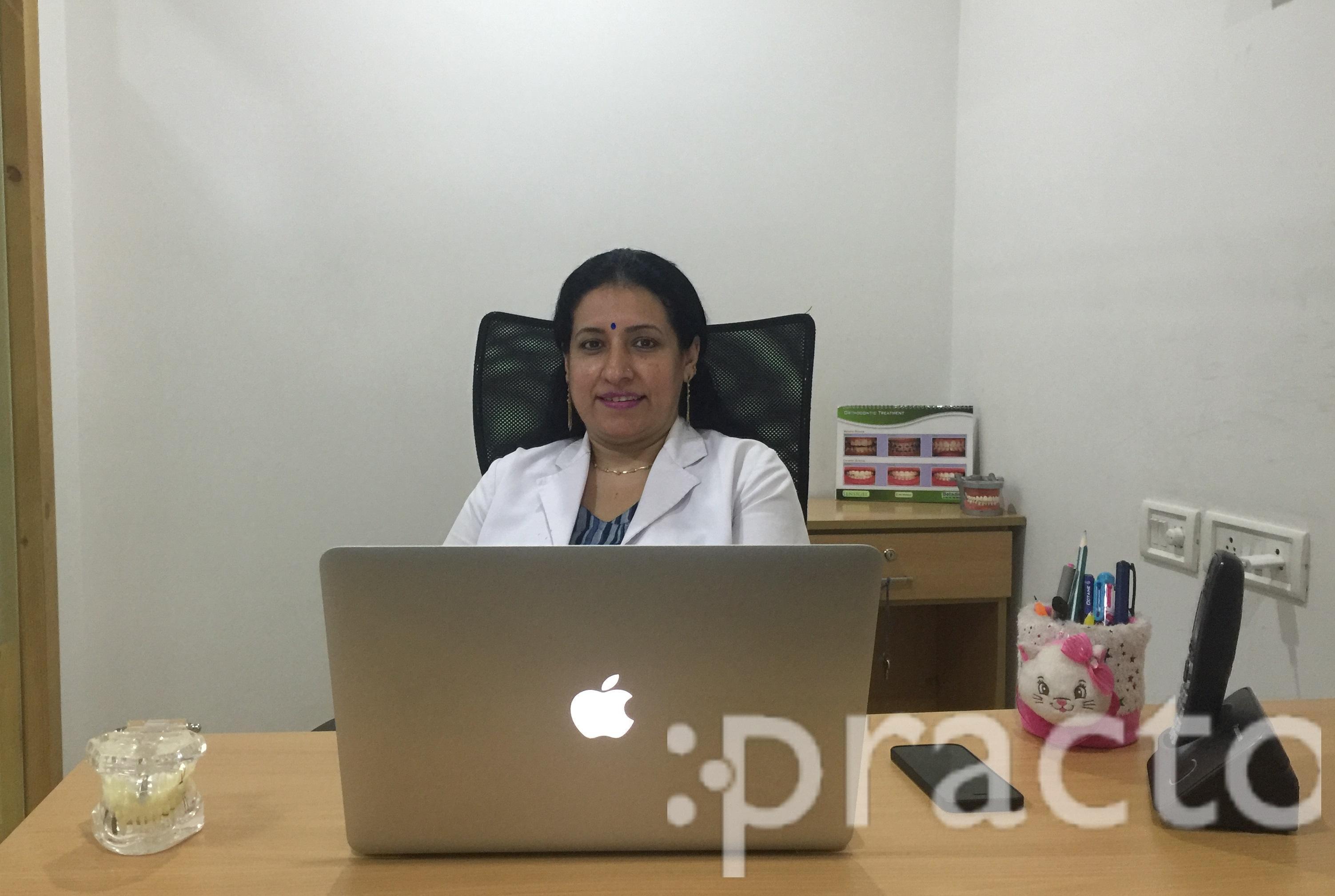 Dr. Nisha C - Dentist