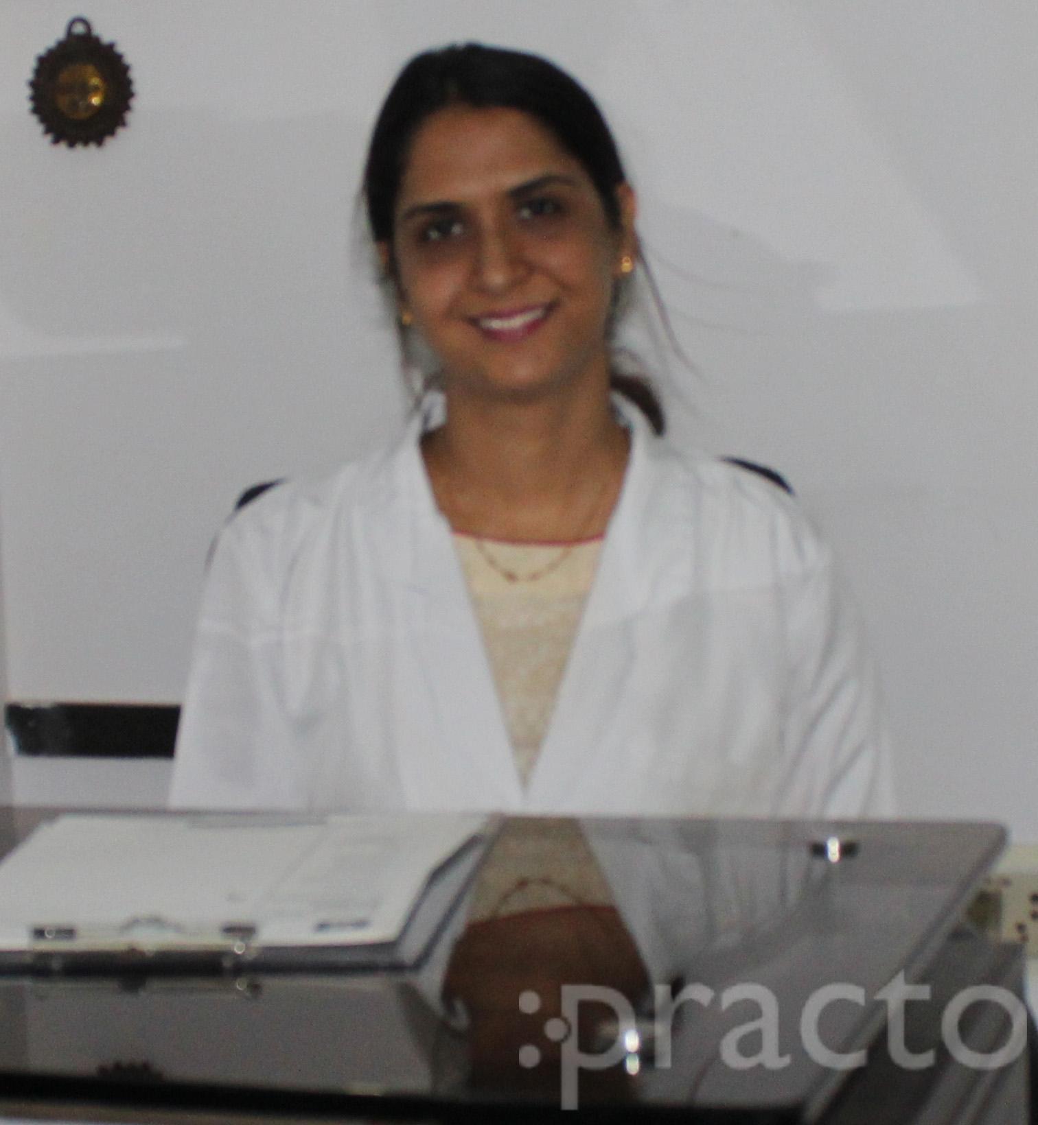 Dr. Pinky K Dhingra - Dentist