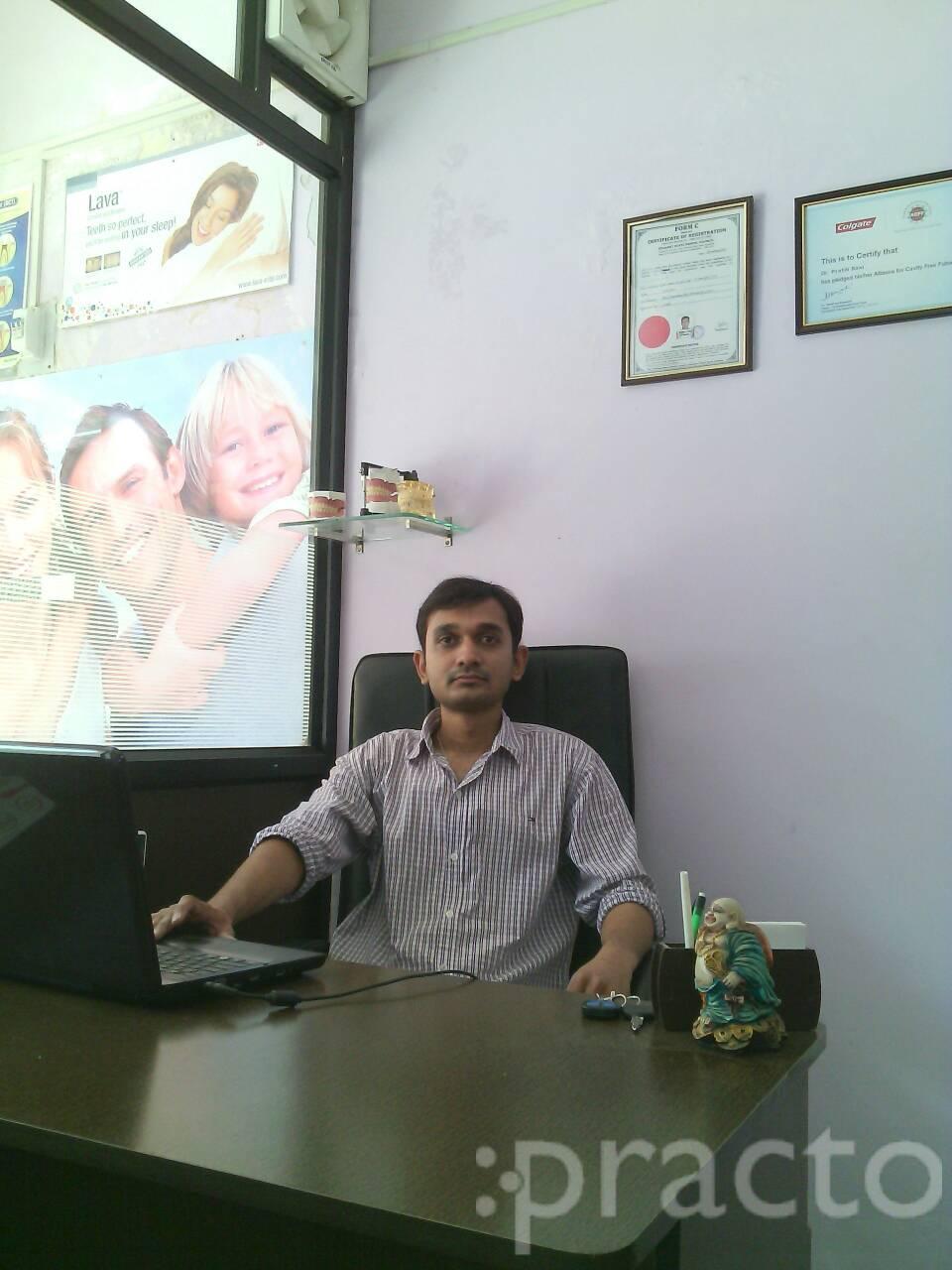 Dr. Pratik Baxi - Dentist