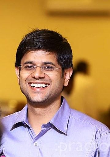 Dr. Pravesh Bizenia - Dentist
